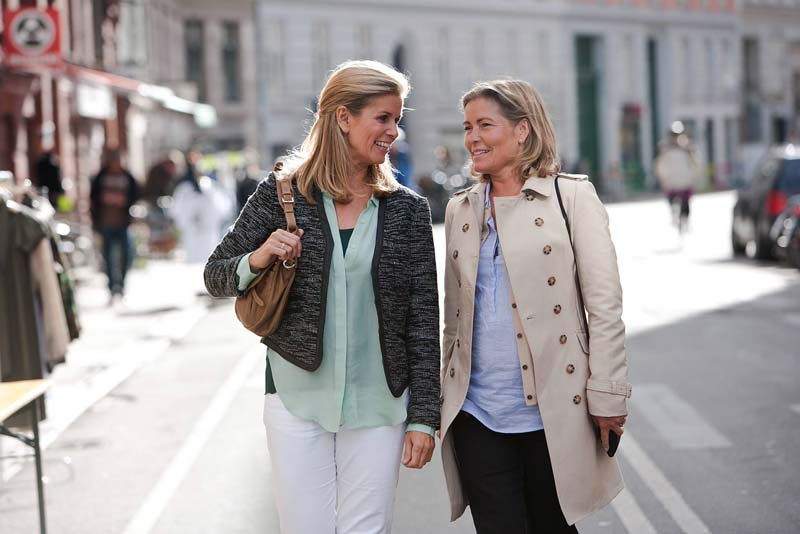 friends shopping wearing hearing-aids