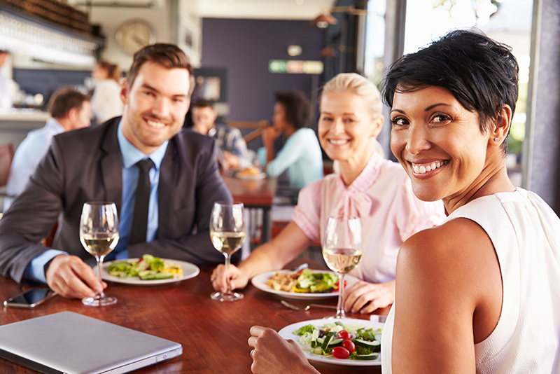 People at restaurant with hearing aids from widex